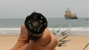 The fibre optic telecommunications cable being connected at Maroochydore.