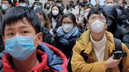 Employers order workers to stay at home after China trips