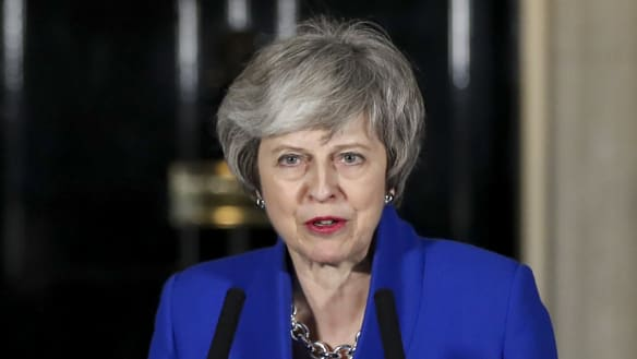 Theresa May after narrowly winning a confidence vote in the British Parliament.