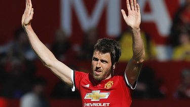 Manchester United's Michael Carrick salutes the fans as he leaves the field after his final playing appearance.
