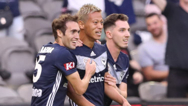 High standards: Keisuke Honda (centre) trains even on days off and wants Victory youngsters to do the same.