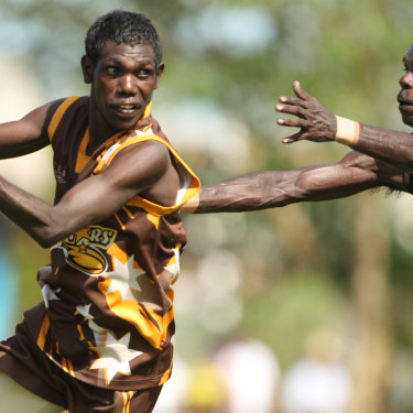 Action from the 2013 grand final between the Imau Tigers and Tapalinga Superstars on Bathurst Island, north of Darwin.
