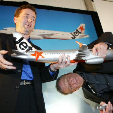 Jetstar's then-CEO Alan Joyce and Qantas boss Geoff Dixon reattaching an engine to a model plane at Jetstar's launch in 2004.