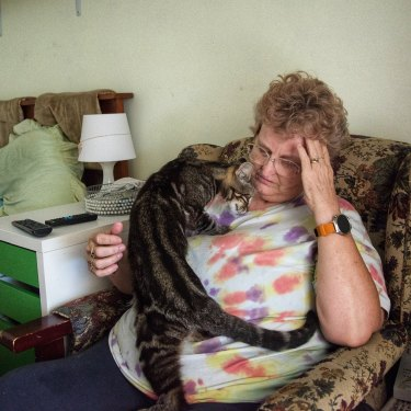 Tina Edgar, 56, places her hand on her temples during the initial phase of a cluster headache attack.