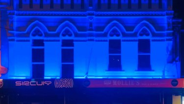 Sircuit bar in Fitzroy was bathed in blue on Thursday to pay tribute to the four police officers killed in the Eastern Freeway tragedy.