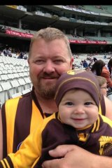 Brett Roberts with daughter at an AFL match in 2013.