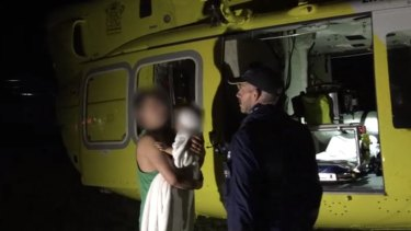 A toddler has been flown to hospital after he was dragged from a caravan by a dingo on Fraser Island.