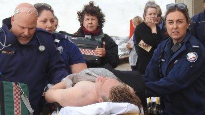 Teens caught in dangerous surf taken to hospital amid wild seas