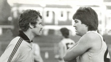 Richmond's Neil Balme gets advice from coach Barry Richardson in 1977.