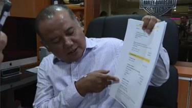 David Fifita's Bali lawyer Muhammad Rifan with a payslip showing the $30,000 payment.