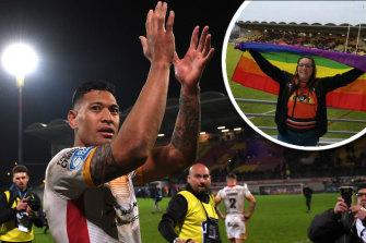 Israel Folau of Catalans Dragonsand inset, a fan displays a rainbow flag.