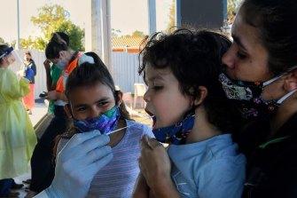 Testing times in Dubbo ... Latisha Carr-McEwan (right) with her children Craig McKellar, 4, and Tashayla Eulo, 9.