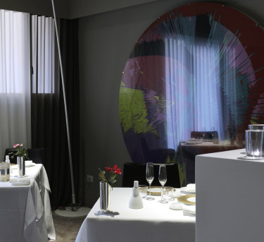 The disc is a Damien Hirst artwork at Osteria Francescana.