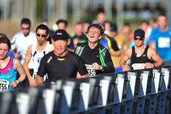 Competitors in the Melbourne Marathon head towards the MCG finish line.