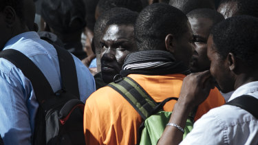 Migrants are detained by French police after being evacuated from the Panthenon in Paris.