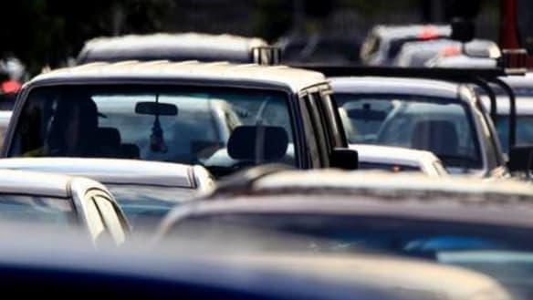 Brisbane traffic: Car rolls on Pacific Motorway, causing delays