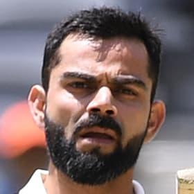 Indian batsman Virat Kohli reacts after scoring a century.