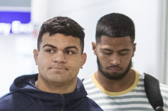 David Fifita and Payne Haas arrive back in Australia after the former was arrested while on holiday in Bali.