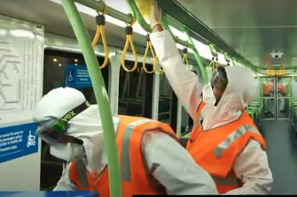 Transclean staff cleaning a Metro train carriage at the height of the COVID-19 outbreak.