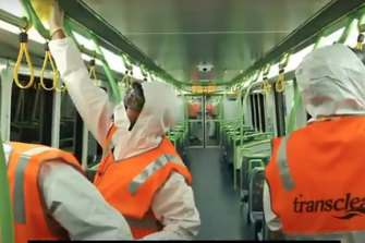 Transclean staff cleaning of Metro train carraiages during the COVID-19 pandemic.