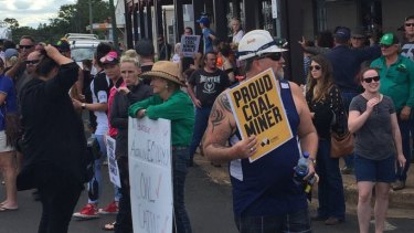 Protestors move to line the main streets of Clermont as the Stop Adani convoy prepares to arrive.