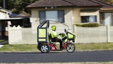 Australia Post has introduced electric tricycles as part of its push to revive the company.