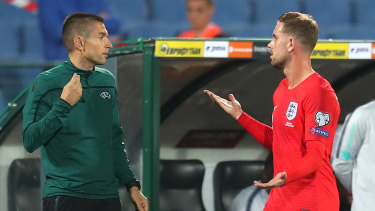 England's Jordan Henderson complains to a match official during the game.