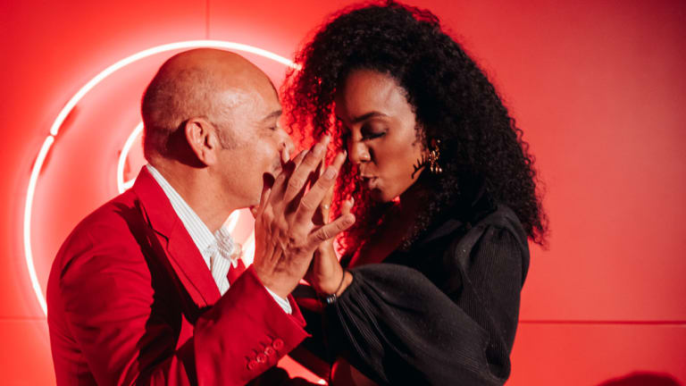 """Christian Louboutin and Kelly Rowland at the """"Loubi Lounge"""" in honour of Christian lastFriday."""