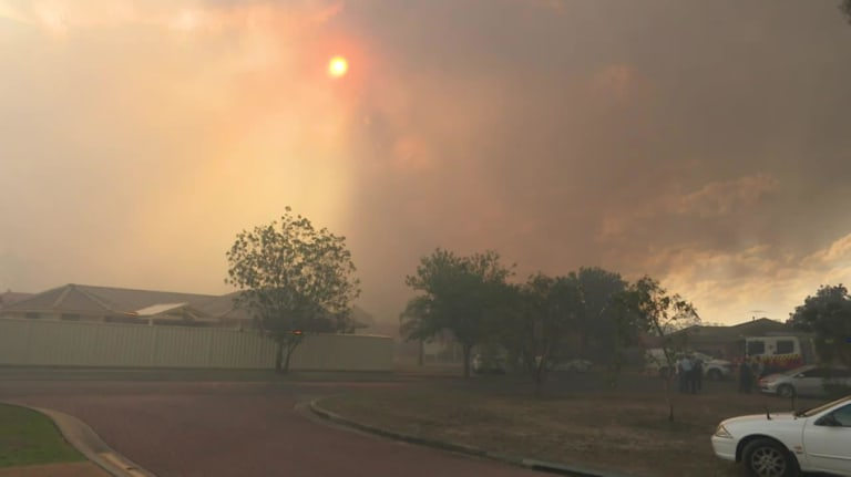 Parts of the city have been blanketed in dark smoke due to the fire.