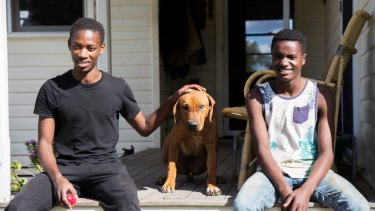 Ezekia Nitanga, 19, left, with his brother. Their family relocated to the New England region after failing to settle in Sydney.