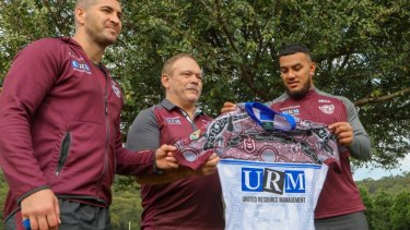 Honour: Cliff Lyons shows off Manly's Indigenous Round jersey with Joel Thompson (left) and Addin Fonua-Blake (right).