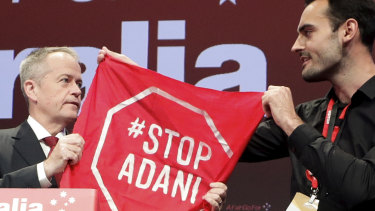 The moment when Bill Shorten was forced to confront an anti-Adani protester on stage.