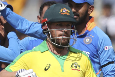 Aaron Finch leaves the field after being run out.
