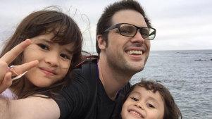 Freelance journalist Scott McIntyre with his two children in Japan.