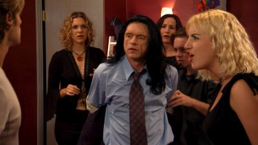Tommy Wiseau, centre, directed, produced and starred in 2003's The Room. It bombed but went on to become a cult hit, spawning James Franco's 2017 movie The Disaster Artist.