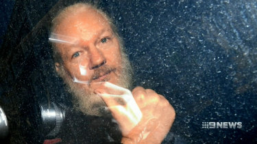 Julian Assange is driven away from the Ecuadorian embassy in London after his arrest.