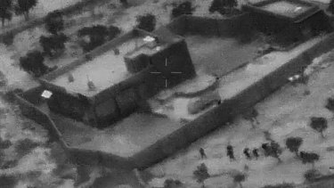 US Special Forces, figures at lower right, moving toward compound of Islamic State leader Abu Bakr al-Baghdadi.