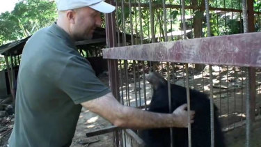 Nigel Grier with one of the captive bears in Mu Aye Pu.