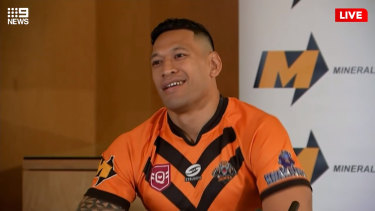 """Israel Folau, wearing a Southport Tigers jersey, said on Friday he was excited to return to the """"grassroots level""""."""