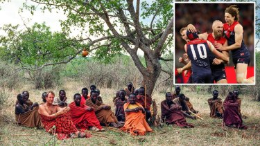 Charles Lane with the nomadic Barabaig people of Tanzania. Inset: Max Gawn celebrates a goal in the prelim final.