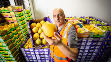 Sam Haddad from HE Heather and Co with his mangoes at Brisbane Markets.
