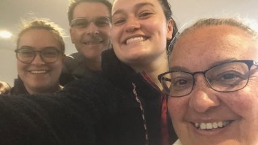 Sarah Krieg, third from left, with, from left, her sibling Ems and parents Michael and Michelle in Albury in July last year before the NSW-Victorian border was shut.