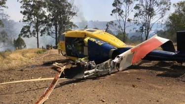 The crashed water bombing helicopter near Toowoomba on Wednesday.