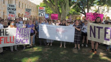 Staff and students rally at the University of Queensland on Friday against proposed changes being imposed on the School of Architecture.