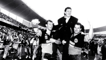Champions: The Panthers celebrate victory over the Raiders in the 1991 grand final.