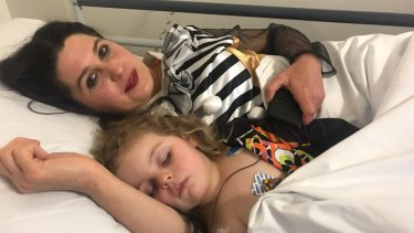 Three-year-old Abby recovering in hospital with her mother Tara.