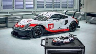 The Lego Technic Porsche 911 RSR, alongside its much larger inspiration.