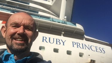 Dr John Parker with the docked Ruby Princess cruise ship.