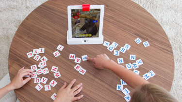 These games, including Tangram, combine physical pieces with a digital screen.
