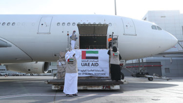 An Etihad Airways flights loaded with aid for the Palestinians to fight the coronavirus pandemic is loaded in Abu Dhabi, United Arab Emirates.